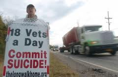 Eighteen suicides a day poster held by Veteran